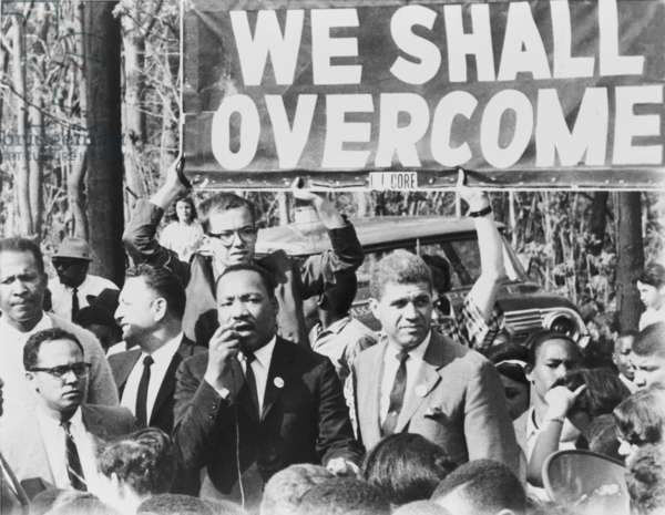 Martin Luther King, Jr. (1929-1968), addressing a crowd on a street in Lakeview, N.Y., May 12, 1965