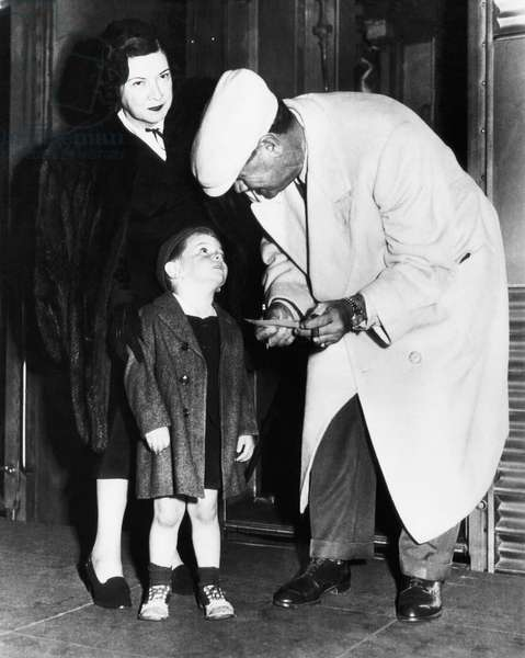 New York Yankees. Claire Hodgson Ruth, Armstead Williams, retired Yankees outfielder Babe Ruth, signing autograph for Williams, 1948