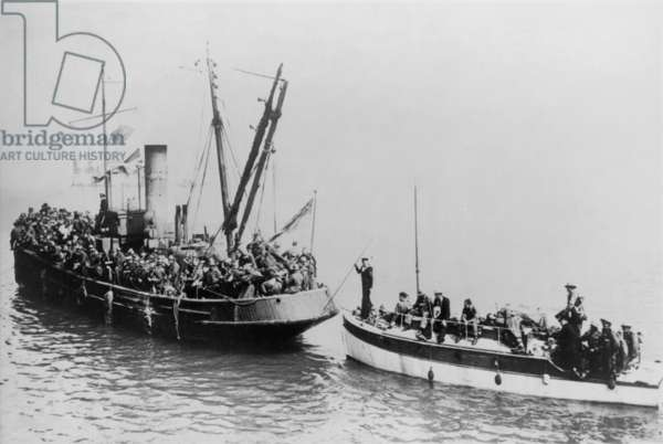 Tug boat with British Expeditionary Forces evacuating Dunkirk, pulls a troops in a small boat. World War 2, May 27-June 4, 1940