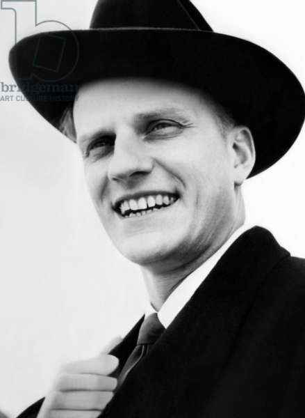 Evangelist, Billy Graham as he arrives in Southampton, England. March 14, 1954.