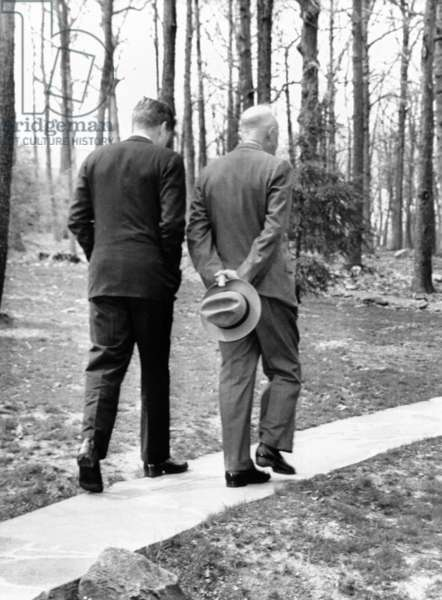 Presidents Dwight Eisenhower and John Kennedy meet after the failed Bay of Pigs invasion. Camp David, Maryland. April 22, 1961