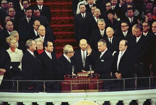Vice-President elect Spiro Agnew takes the oath of office from Senate Minority Leader Everett Dirkson. Also pictured are Lyndon Johnson Richard Nixon Hubert Humphrey Billy Graham. Jan. 20 1969