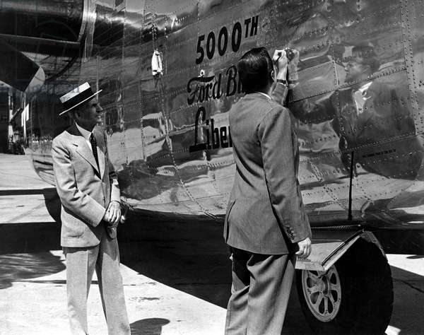 Henry Ford & grandson Henry Ford II, sign 5,000th Liberator bomber built, 9/9/44