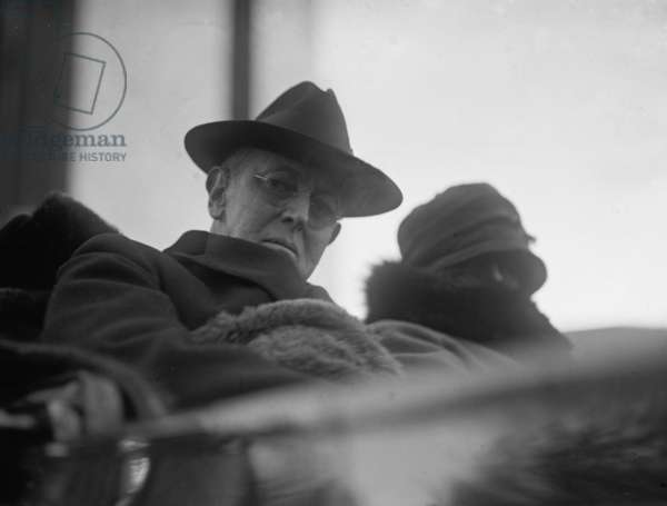 Woodrow Wilson (1856-1924) and his second wife, Edith Bolling Galt Wilson riding in an open carriage in Washington, DC in 1923. President Wilson shows the effects of a severe stroke he suffered the previous year on October 2, 1919