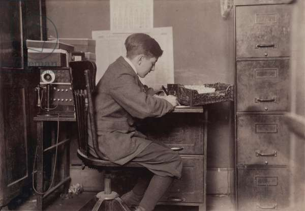 Young office boy, working for J.J. O'Brien and Sons on East 23 Street, over 16 years old, New York City, photograph by Lewis Wickes Hine, January, 1917