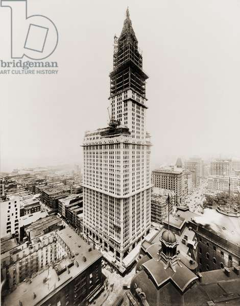 Woolworth Building during the last stages of exterior construction. The tower takes shape and most of the building exterior is faced with white terra cotta. July 1, 1912