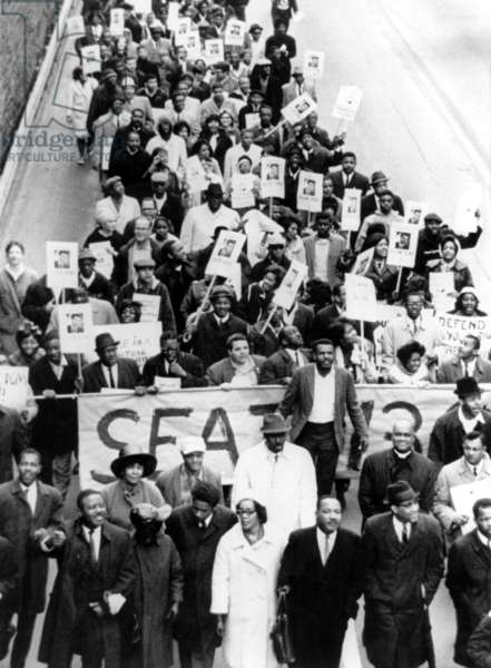Dr. Martin Luther King Jr. (bottom, 3rd from right), with wife Coretta Scott King (bottom, center), leading a march of 800 demonstrators to protest the ousting of Georgia State Representative-elect Julian Bond, by the General Assembly, Atlanta, GA, January 10, 1966