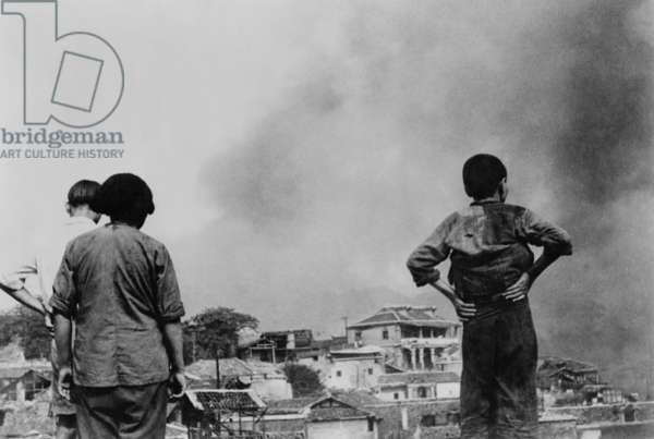 Three Chinese civilians in Chungking witness a Japanese air-raid. Second Sino-Japanese War/ World War 2. c.1937-45