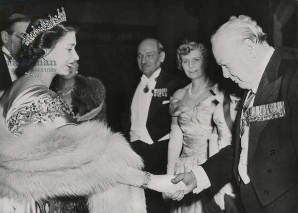 Princess Elizabeth welcomes Winston Churchill and Prime Minister Clement Atlee at Guildhall. The former and current Prime Ministers joined 700 guests at a charity fund raising dinner. March 23, 1950.