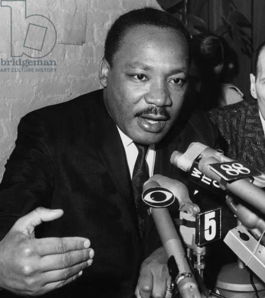 Dr. Martin Luther King Jr. talks to the press at Harlem's Canaan Baptist Church in New York, March 24, 1968.
