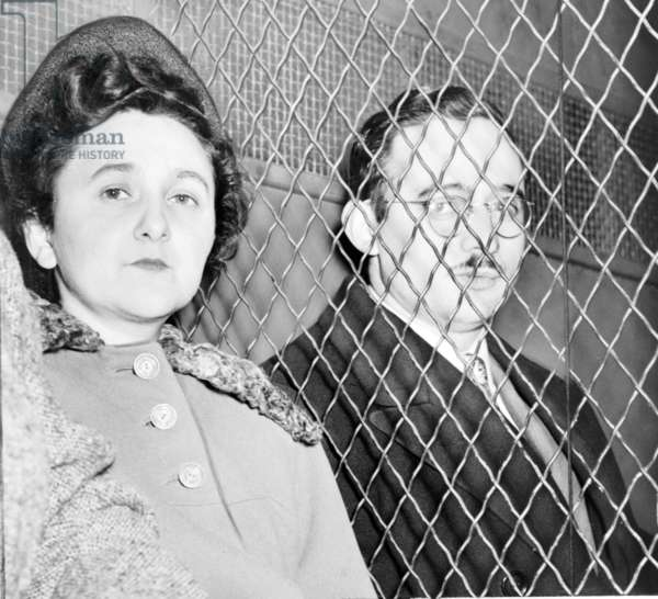 Ethel and Julius Rosenberg, separated by heavy wire screen as they leave U.S. Court House after being found guilty of treason by a jury. photo by Roger Higgins. 1951