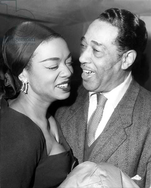 PARIS: American jazz band leader Duke Ellington chats with pianist-singer Hazel Scott at a reception given in his honor at the American Cultural Center in Paris. The Duke is currently giging a series of jazz concerts in Paris. 10/29/58