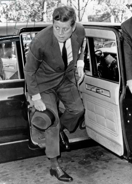 President John Kennedy steps from his limousine during the Cuban Missile Crisis. He was attending mass at St. Stephens church. Later in the day the crisis broke, when Soviet Premier Khrushchev announced that Russia would dismantle the missile bases in Cuba. Oct. 28, 1962