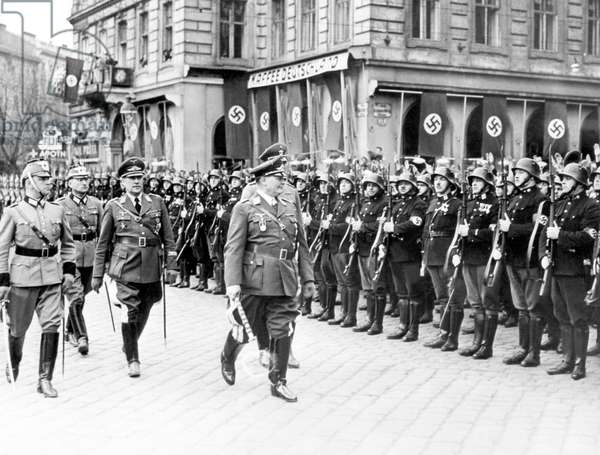 Hermann Goering, (foreground, center), greeting Vienna Police officers who are lined up in front of his hotel, Austria, 1938.