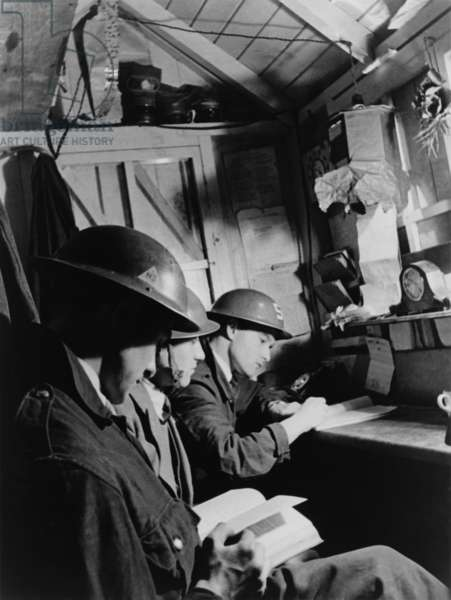 Teenagers manned the Air Warden's post in a South East London Shelter during World War 2. c. 1940-1945
