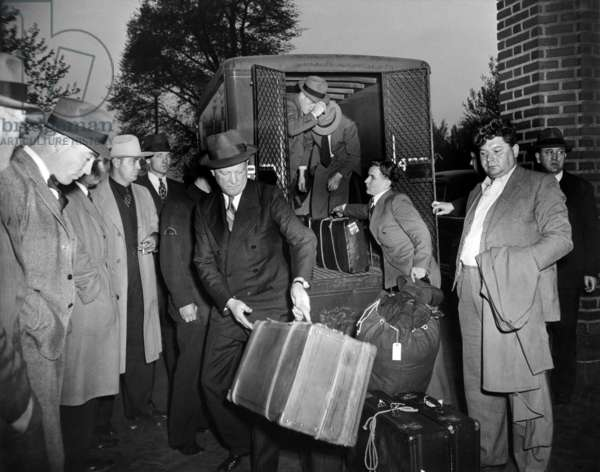 German sailors stranded in New York City since the outbreak of the war in Europe, were taken to Ellis Island. The German aliens were rounded up by U.S. Immigration Service agents and police early on the morning of May 7, 1941