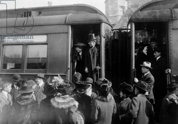 President elect Woodrow Wilson, surrounded by Princeton University undergraduates, boarding a train to Washington D.C., Princeton, New Jersey, 1913.