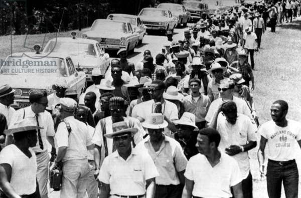 Martin Luther King Jr. (center, foreground), leads his 'Mississippi Freedom Machers' into Yalobusha County, which is said to be one of the roughest counties in the state, Enid, Mississippi, June 12, 1966.