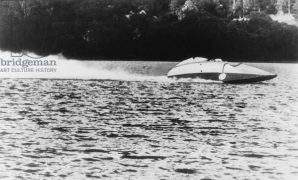 Sir Malcolm Campbell speeds over Lake Coniston in Bluebird II it a trial run in June 1947 He was preparing to beat his own world speedboat record of 141.7 mph set in 1939. Unfortunately the Jet powered craft was unstable and could not reach record high speeds.