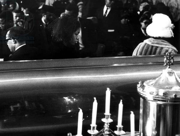 A Last Look: Mrs. Betty Little Shabazz, widow of Malcolm X, walks away from coffin after viewing the body of her husband during funeral services February 27th, 1965.
