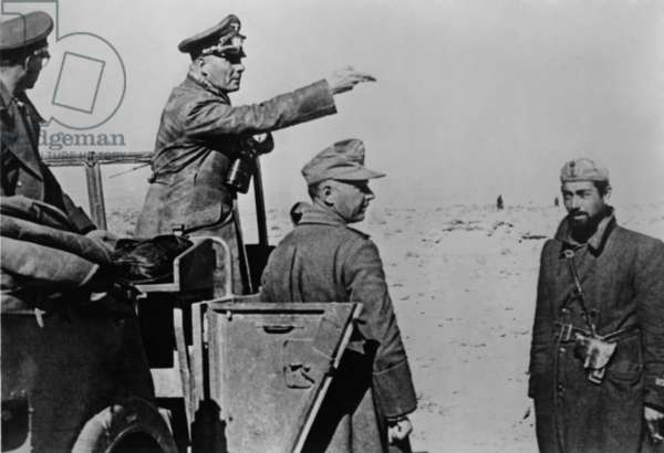 General Rommel standing in jeep in the North African desert, Feb. 1-10, 1942. World War 2. Rommel's German-Italian forces were resupplied with tanks and fuel in January 1942. He soon captured Benghazi, Libya. He defeated the British at Tobruk on June 21, 1942