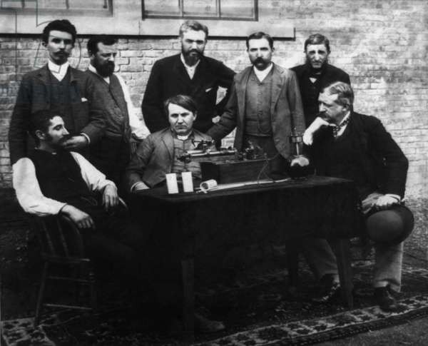 Thomas A. Edison and his staff engineers/inventors, with their wax recording phonograph. Portrait shows Edison seated in center, with Fred Ott at left and Col. George Gouraud at right. Standing (left to right) are W.K.L. Dickson, Charles Batchelor, A. Thedore Wangemann, John Ott, and Charles Brown
