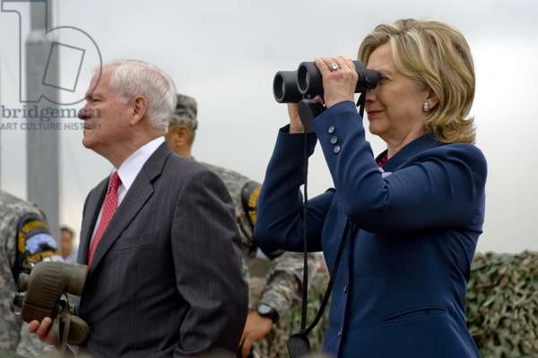 Hillary Clinton and Robert M. Gates look out over North Korea from Observation Point Ouellette during a tour of the Demilitarized Zone in South Korea. July 21 2010