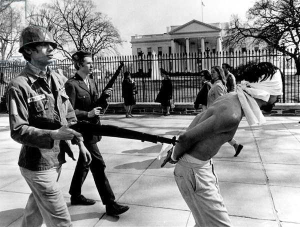 Anti-Vietnam War Protestors calling themselves 'Spring Mobilization for Peace', demonstrating with toy rifles in front of the White House, Washington D.C., 04-08-67
