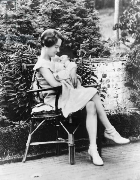 Anne Morrow Lindbergh in 1930, holding her first son, Charles A. Lindbergh Jr., a few weeks after his birth. He would be kidnapped and murdered before his 2nd birthday
