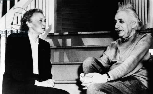 Madame Joliot-Curie and Albert Einstein. The two Nobel Prize winning physicists talk on the steps of Einstein's home in Princeton. March 1948