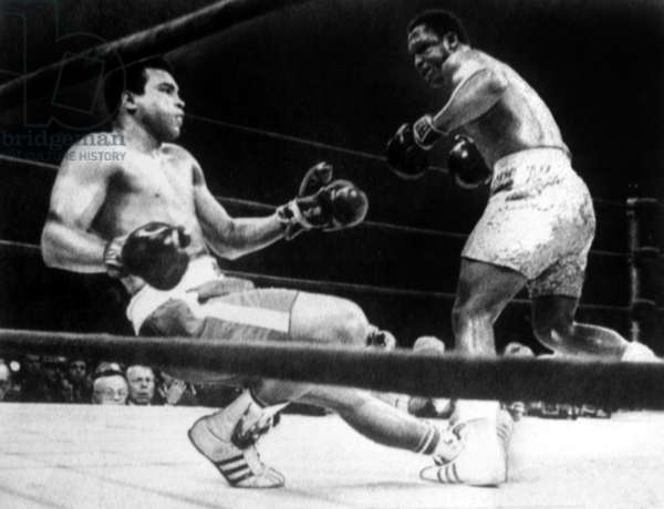 Muhammad Ali knocked down by Joe Frazier in their first title match in Madison Square Garden, 1971