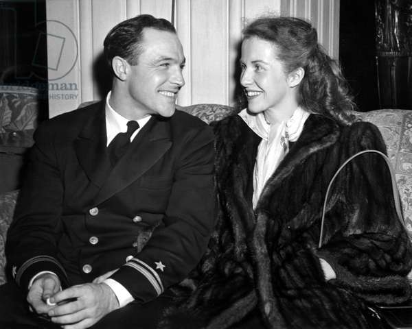 LT. (J.G.) GENE KELLY, on leave from making naval training films, steps out with his wife BETSY BLAIR, 10/14/45