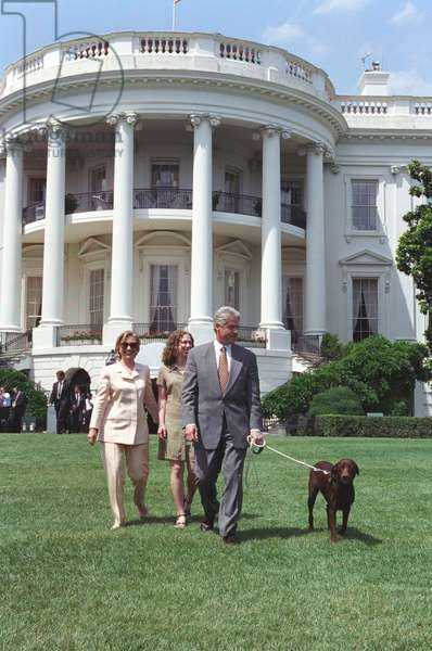President Bill Clinton, Hillary and Chelsea Clinton, and Buddy the Dog on the South Lawn. July 24, 1998