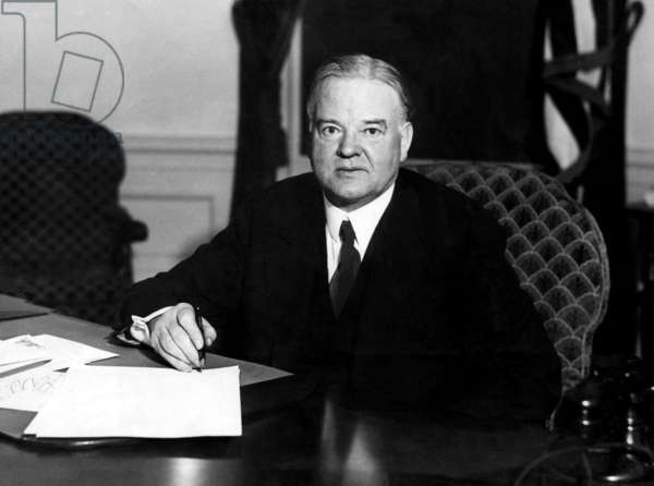 President Herbert Hoover signs unemployment relief bills passed by congress, ca 1939.