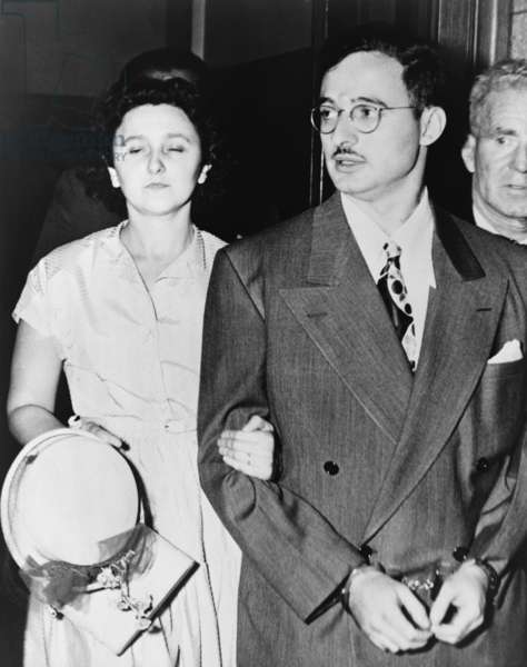 Ethel and Julius Rosenberg leaving New York City Federal Court after their arraignment conspiracy to commit espionage, August 23 1951 (b/w photo)