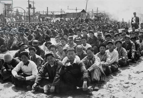 North Korean and Chinese Communist prisoners assembled in a UN POW camp at Pusan, Korea. April 1951. Korean War, 1950-53