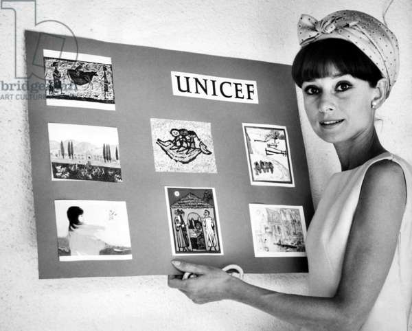 Audrey Hepburn officially lauches the 15th Anniversary UNICEF greeting card campaign in Madrid Spain. August 15, 1964.