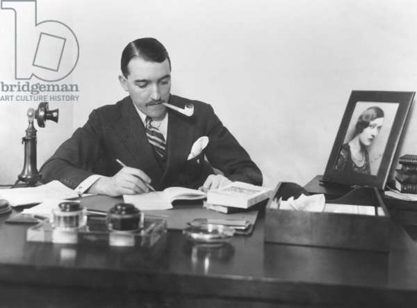 Marquis de la Falaise, 3rd husband of Gloria Swanson, at his small office on 42nd St., NYC. Dec. 1925. He was married to Gloria Swanson from 1925–1931, and to Constance Bennett from 1931–1940. In both marriages he worked as a film director, film producer, and sometimes actor