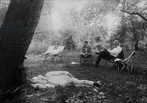 Thomas Edison naps under a tree, on July 19, 1921. In the background President Warren Harding reads a newspaper in a camp chair next to Harvey Firestone. Maryland