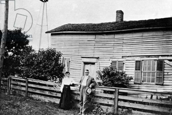 Warren G. Harding, 29th President of the United States (1921-1923) poses in front of his birthplace, Corsica, Ohio. Next to him is his cousin Ada, c. 1910.
