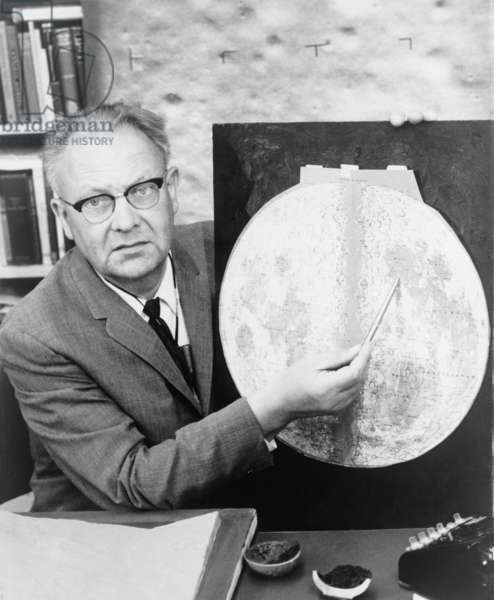 Gerard P. Kuiper (1905-1973), Dutch born American astronomer, holding pointer to a map of the moon. He helped identify landing sites on the moon for the Apollo landing in July 1969 and later missions