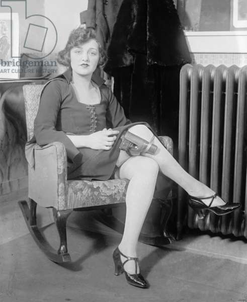 Mary Jayne, a stylish roaring twenties beauty, adds a concealed gun to her wardrobe in 1922