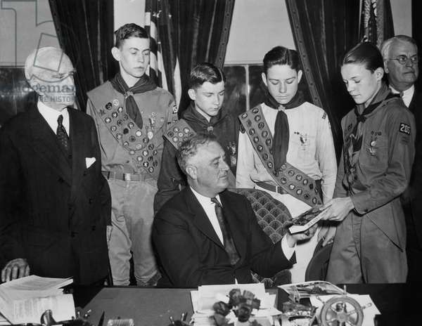 FDR Presidency. US President Franklin Delano Roosevelt being presented with the 5,000,000th copy of the Boy Scout Handbook, 1935