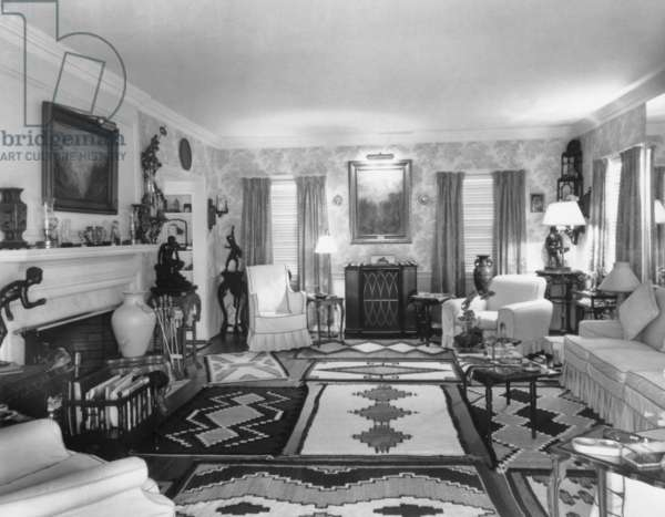 Living Room of J. Edgar Hoover's living room at the 4936 Thirtieth Place, NW Washington, D.C. The room was decorated with Native American rugs, classicist sculptures of male nudes, decorative vases, and landscape paintings. c. 1950