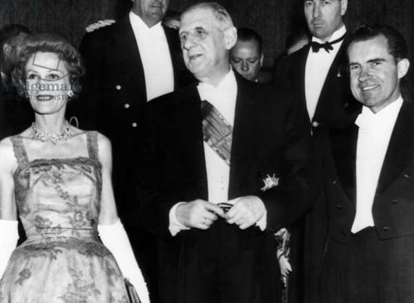 Pat Nixon, French President Charles de Gaulle and Vice President Richard Nixon at a dinner in Washington D.C., 1960