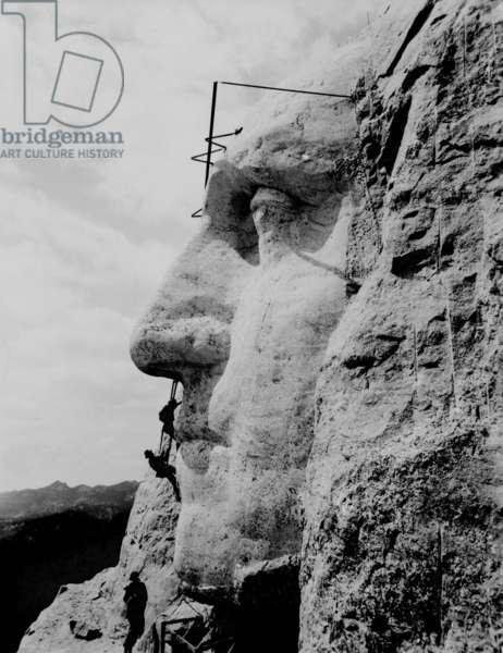 Workmen on face of George Washington at Mount Rushmore, South Dakota. 1932