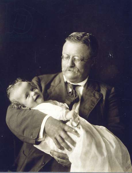 Theodore Roosevelt smiling as he holds his grandchild, Kermit Roosevelt, Jr. 1916 photo. The baby grew up to be director of the CIA's Near East and Africa division, and directed the 1953 coup that brought Reza Shah Pahlavi to power