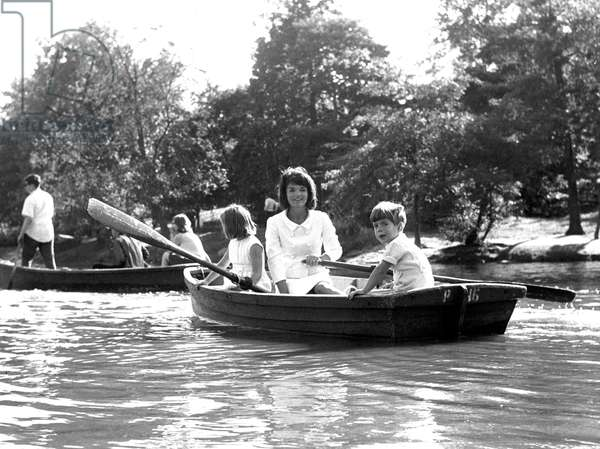 Jacqueline Kennedy, with children Caroline Kennedy, John F. Kennedy Jr., in Central Park Lake, New York City, 1964