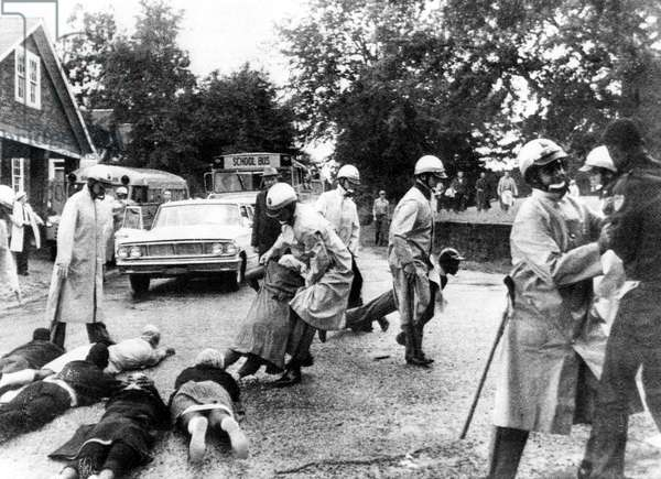 CIVIL RIGHTS, Crawfordville, Georgia, Black demonstrators block school buses carrying white students after the protestors were refused passage aboard the buses. October 1, 1965