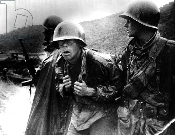 Korean War: Wounded rifleman with comrade, Korea, 1950